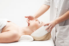 A young blond woman on a spa procedure royalty free stock images