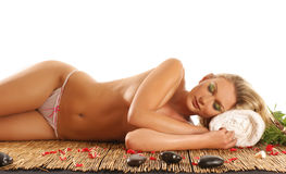 A young blond woman on a spa treatment procedure Royalty Free Stock Photo