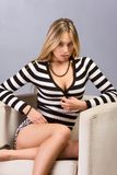 Young blond woman in striped blouse and shirts Royalty Free Stock Photo