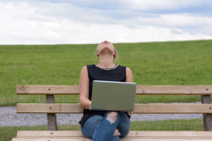 Young blond woman takes a short break Royalty Free Stock Photo