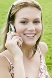 Young blond woman talking on her cell phone stock photography