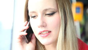 Young blond woman talking on mobile, phone, cell while riding tram stock footage