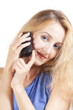Young blond woman talking by phone Stock Image