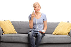 Young blond woman talking on telephone Stock Photography