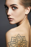 Young blond woman with tattoo Royalty Free Stock Photo