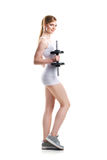 Young blond woman training with dumbbells Royalty Free Stock Photo