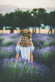 Young blond woman traveller standing in lavender field, Isparta, Turkey royalty free stock photography