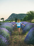 Young blond woman traveller walking in lavender field, Isparta, Turkey stock image
