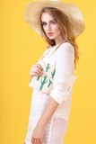 Young blond woman in tunic and hat in studio Royalty Free Stock Photos