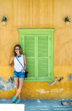 Young blond woman in typical Greek town with colorful buildings on Kastelorizo Island, Greece Stock Images
