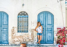 Young blond woman at typical greek traditional town with colorful buildings on Kastelorizo Island, Greece. Europe Stock Images