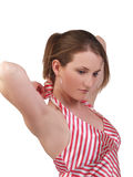 Young blond woman untieing red and white top Royalty Free Stock Photography