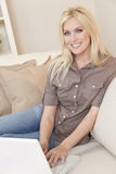 Young Blond Woman Using Laptop Computer At Home Royalty Free Stock Images