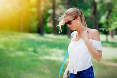 Young blond woman walking in park Stock Photos