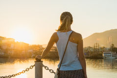 Young blond woman watching sunset Royalty Free Stock Photography