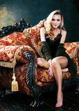 Young blond woman wearing crown in fairy luxury interior with em. Pty antique frames total wealth, rich lifestyle concept close up Stock Photos