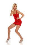 Young Blond Woman wearing a red dress Royalty Free Stock Photos