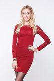 Young Blond Woman wearing a red dress Stock Photos