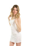 Young blond woman. Wearing short white dress. Isolated stock photo