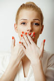 Young blond woman on white backgroung gesture. Thumbs up,  emotional closeup Stock Images
