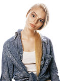 Young blond woman on white backgroung gesture thumbs up,  emotional posing close up Stock Photo
