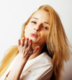 Young blond woman on white backgroung gesture thumbs up, isolate. Young blond woman on white backgroung smiling gesture thumbs up, isolated emotional posing Royalty Free Stock Image
