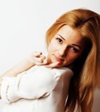 Young blond woman on white backgroung gesture thumbs up, isolate Stock Photo