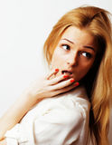 Young blond woman on white backgroung gesture thumbs up, isolate Royalty Free Stock Images