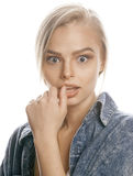 Young blond woman on white backgroung gesture. Thumbs up, isolated emotional Stock Image