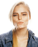 Young blond woman on white backgroung gesture. Thumbs up, isolated emotional closeup Stock Photography
