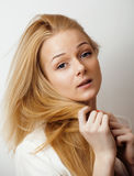 Young blond woman on white backgroung gesture thumbs up, isolated emotional posing close up, lifestyle people concept Royalty Free Stock Photos