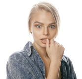 Young blond woman on white backgroung gesture thumbs up, isolated emotional posing close up Stock Photography