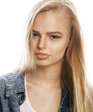 Young blond woman on white backgroung gesture thumbs up, isolated emotional posing close up Stock Photo