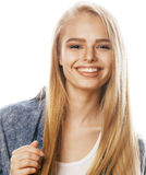 Young blond woman on white backgroung gesture thumbs up, isolated emotional posing close up Royalty Free Stock Images
