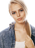 Young blond woman on white backgroung gesture thumbs up, isolated emotional posing close up Royalty Free Stock Image