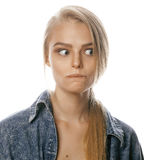 Young blond woman on white backgroung gesture. Thumbs up, isolated hipster emotional Stock Image