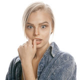 Young blond woman on white backgroung gesture. Thumbs up, isolated hipster emotional Royalty Free Stock Image