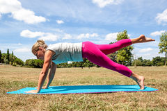 Young blond woman working out to loose weight outside Royalty Free Stock Photo