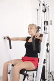 Young blond woman workout in gym Royalty Free Stock Photo