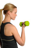 Young Blond womna lifting a bumbbell Stock Photo