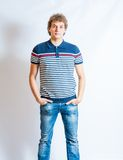 Young blonde adult caucasian man in casual clothes. On a gray background. Not Isolated. This image has attached release Royalty Free Stock Photo