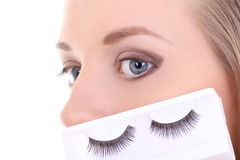 Young blonde with artificial eyelashes Royalty Free Stock Image