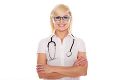 Young blonde attractive doctor with arms crossed Stock Photo