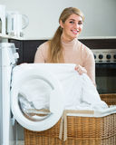 Young blonde with basket of linen Stock Photos