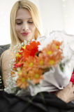 Young blonde beautiful woman with bunch of flowers. Blonde beautiful woman with bunch of flowers Royalty Free Stock Photos
