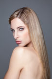 Young blonde beauty with straight hair Stock Photography