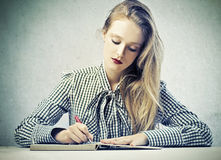 Young Blonde Beauty Writing Royalty Free Stock Photography