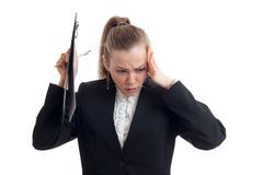 Young blonde in black business jacket raised a Tablet and clings to head hand Royalty Free Stock Image
