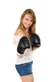 Young blonde with boxing gloves Royalty Free Stock Photo