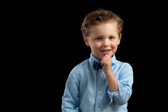 Young Blonde Boy Bow Tie Hand Chin Stock Photography